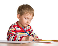 Child studies to draw Royalty Free Stock Image