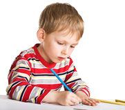 Child studies to draw Stock Photo