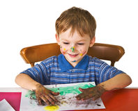 Child studies to draw Stock Photography