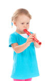 Child in the studio playing the flute Royalty Free Stock Photo