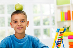 Child study and have apple in head Stock Images