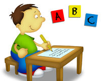 Child Studying. Little boy sitting and writing the alphabet Royalty Free Stock Photos