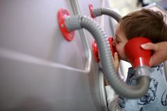 Child studying acoustics. Child is studying acoustics in a museum Royalty Free Stock Image