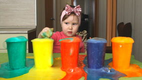 The child is studying colors. stock video footage