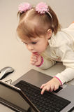 Child is studying computer. The child makes the first steps in mastering the computer Royalty Free Stock Photo