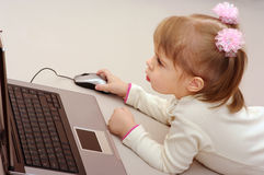 Child is studying computer Royalty Free Stock Images