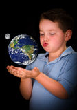 Child studying earth in education concept Royalty Free Stock Photos