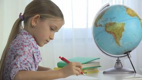 Child Studying Earth Globe, Girl Writing for School at Office, Learning Kid stock photos