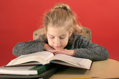 Child studying head down. Shot of a child studying head down Royalty Free Stock Photos