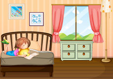 A child studying inside her room Royalty Free Stock Images
