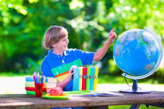 Child studying in school yard Royalty Free Stock Images