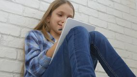 Child Studying on Tablet, Girl Writing for School Class, Learning Doing Homework royalty free stock photos