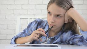 Child Studying on Tablet, Girl Writing in School Class, Learning Doing Homework royalty free stock image