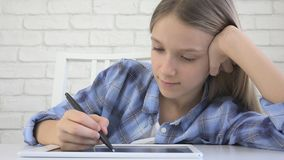 Child Studying on Tablet, Girl Writing in School Class, Learning Doing Homework stock images