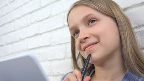 Child Studying on Tablet, Girl Writing for School Class, Learning Doing Homework royalty free stock photography