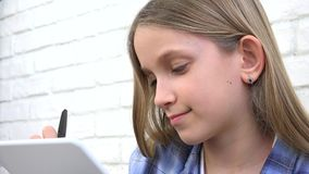 Child studying on tablet, girl writing for school class, learning doing homework.  stock video