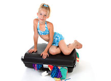 Child on stuffed suitcase Stock Photos
