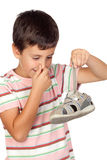 Child with a stuffy nose taking a sandal. Child with a stuffy nose taking the sandal isolated on white background Royalty Free Stock Image