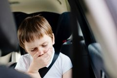 Child suffers from motion sickness in car Stock Photography