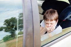 Child suffers from motion sickness in car Stock Images