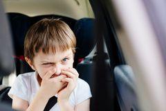Child suffers from motion sickness in car Stock Photos