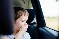 Child suffers from motion sickness in car Royalty Free Stock Image