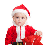 The child in a suit of Santa Claus Stock Photos