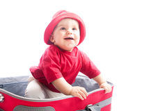 Child in suitcase Stock Images