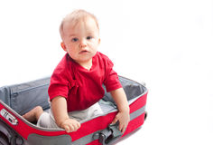 Child in suitcase. On a white background Royalty Free Stock Photos