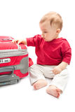 Child with suitcase. On a white background Royalty Free Stock Photo