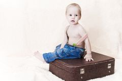 Child and suitcase Royalty Free Stock Images