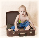 Child and suitcase Stock Photo