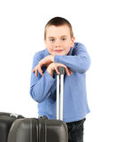 Child with suitcase. Portrait of young boy with suitcases, studio shot Royalty Free Stock Photo
