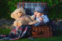 Child in suitcase. With blanket and big toy bear Stock Images