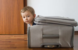 Child in suitcase. Funny child in suitcase all packed and ready to travel Stock Photos