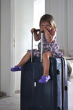 Child on the suitcase. Child waiting on the suitcase Royalty Free Stock Photos