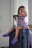 Child on the suitcase. Child waiting on the suitcase Royalty Free Stock Photography