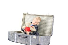 Child in a suitcase, white background Royalty Free Stock Images