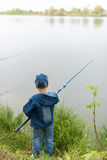 Child on a summer fishing on the shore Stock Image