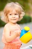 Child in summer garden. Beautiful smiling child in summer garden stock photo
