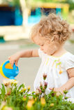 Child in summer garden stock photo