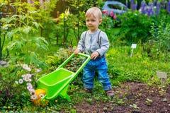 Child in summer garden Stock Images