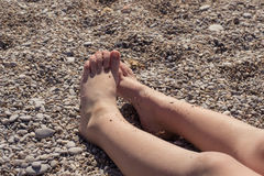 Child sunbathe on the beach Royalty Free Stock Images