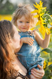 Child with sunflower Royalty Free Stock Photo