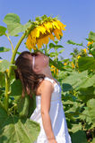 Child sunflower on field Royalty Free Stock Photos