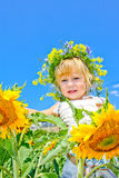 The child in sunflowers. Beautiful little girl and sunflowers Stock Photo