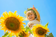 The child in sunflowers. Beautiful little girl and sunflowers Stock Images