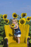Child with sunflowers royalty free stock image