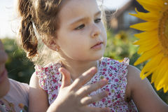 Child in sunflowers. Happy daughter and mama on the field with sunflowers royalty free stock images