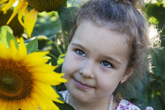 Child in sunflowers Stock Photo